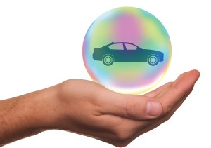 Car in floating orb with hand holing it